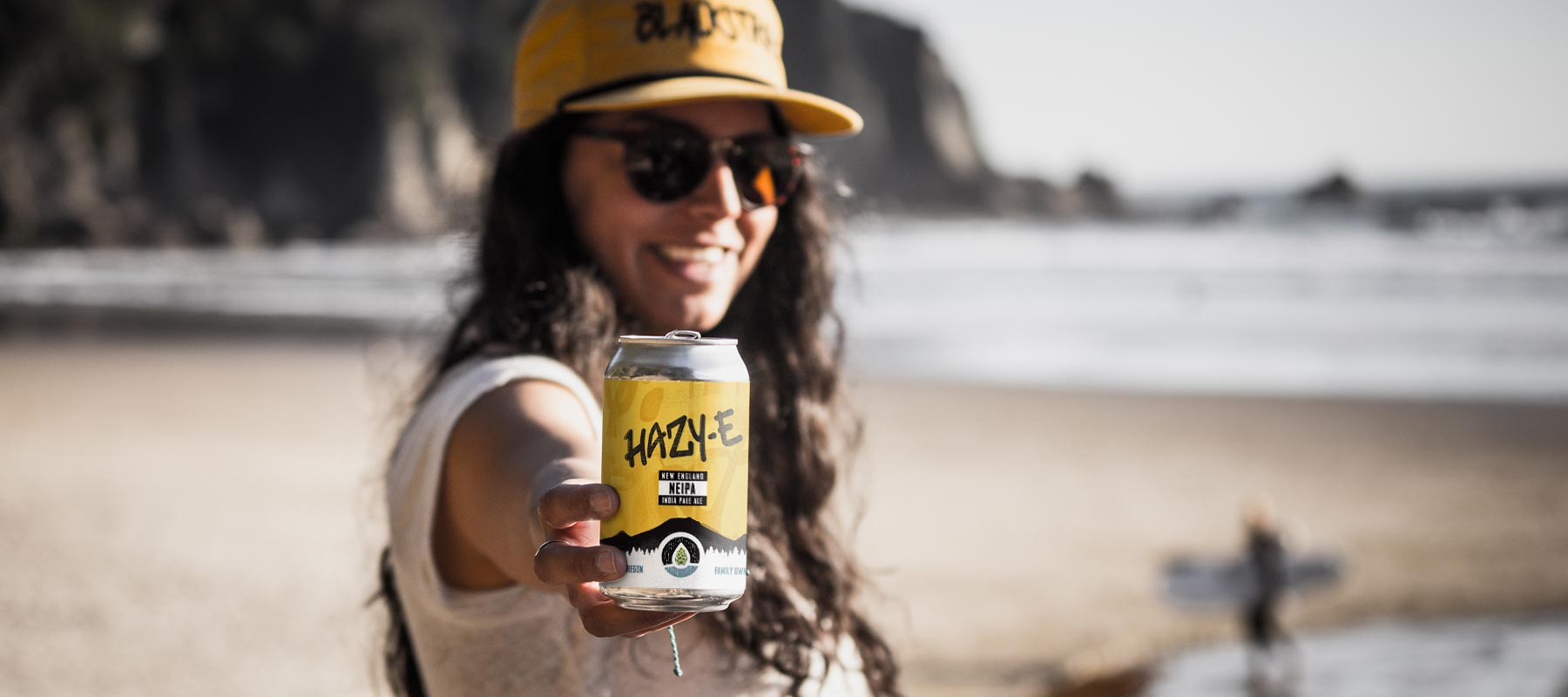 Girl Holding Hazy-E Immersion Brewing Beer